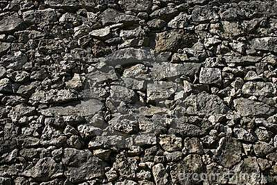 solid-stone-wall-13652038