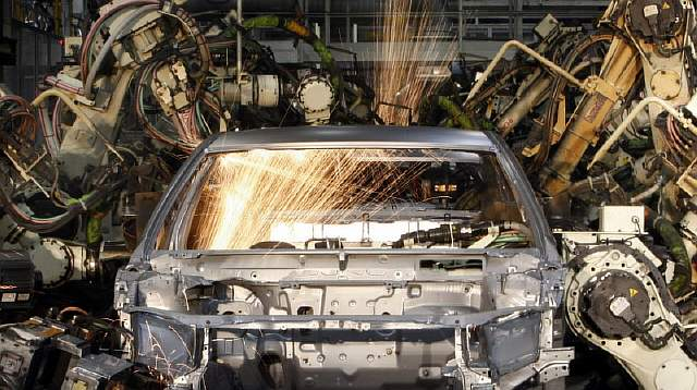 Robots weld the bodyshell of a Toyota Camry Hybrid car on the assembly line at the Toyota plant in Melbourne