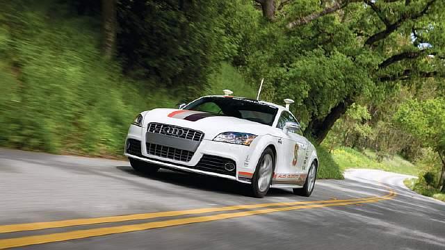 http://gearmix.ru/wp-content/uploads/2015/02/Audi-TTS-Pikes-Peak-Driverless-Car.jpg