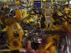 Robots perform spot welds on metal Ford Escape sports utility vehicle frames during the assembly process at the Ford Motor Co. Louisville Assembly Plant in Louisville, Kentucky, U.S. on Tuesday, April 28, 2015. Photographer : Luke Sharrett / Bloomberg