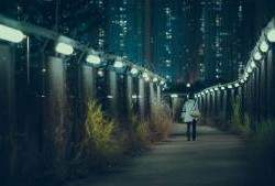 Walking alone on pathway in dark