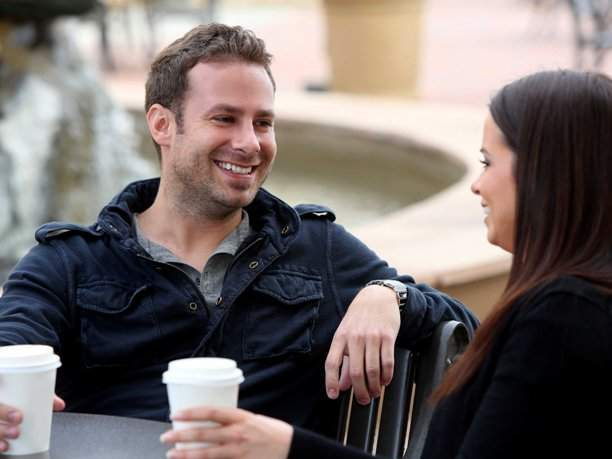first-date-couple-smiling-laughing