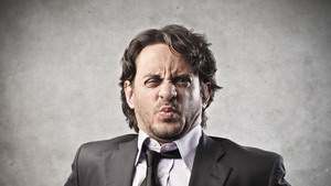 17254729-ortrait-of-businessman-disgusted-on-a-gray-background-640x0
