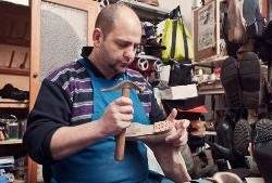 Cobbler at work with a hammer
