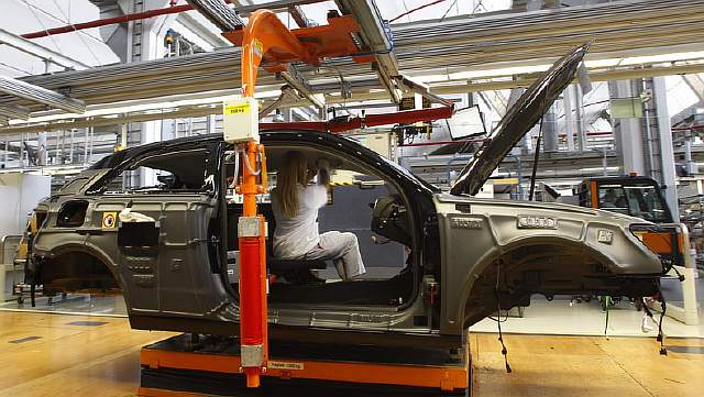Worker assembles Audi A3 at production line of German car manufacturer's plant in Ingolstadt