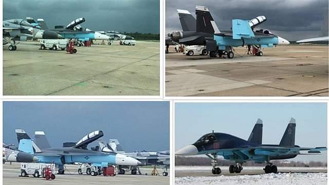 Подпись к изображению: Американский палубный истребитель-бомбардировщик Макдоннел-Дуглас F/A-18, раскрашенный в российские цвета, рядом с российским Су-34