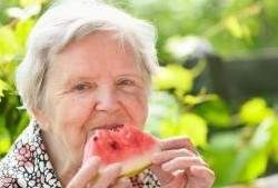 older-woman-eating-watermelon