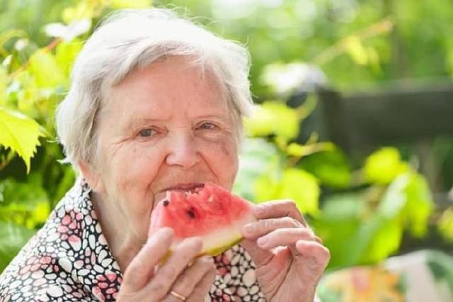 older-woman-eating-watermelon